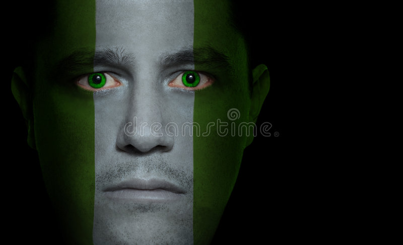 Nigerian Flag - Male Face. Nigerian flag painted/projected onto a man's face royalty free stock photography