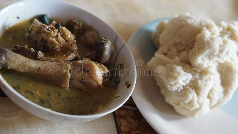 Nigerian food. Pounded yam and White soup royalty free stock photos