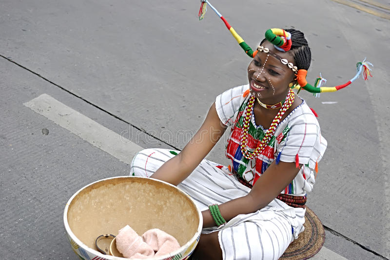 Nigerian girl. CHENGDU - MAY 23: Nigerian artist perform folk music in the 1st International Festival of the Intangible Cultural Heritage China,2007 on May 23 stock photo