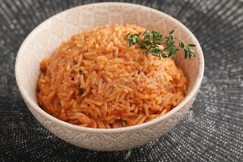 Nigerian Jollof Rice. With thyme royalty free stock images