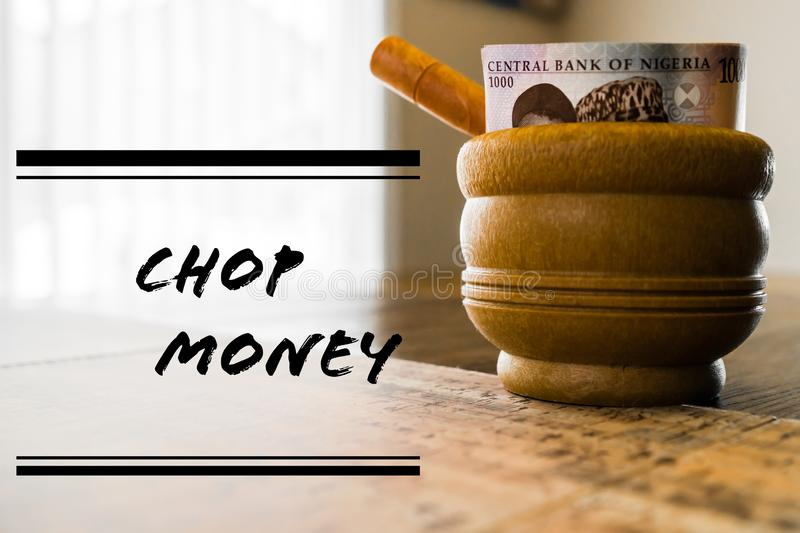 Nigerian mortar and pestle with Nigerian naira notes royalty free stock images