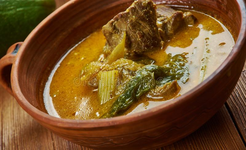 Nigerian okazi soup. Nigerian cuisine - okazi soup , Traditional assorted dishes, Top view royalty free stock photography