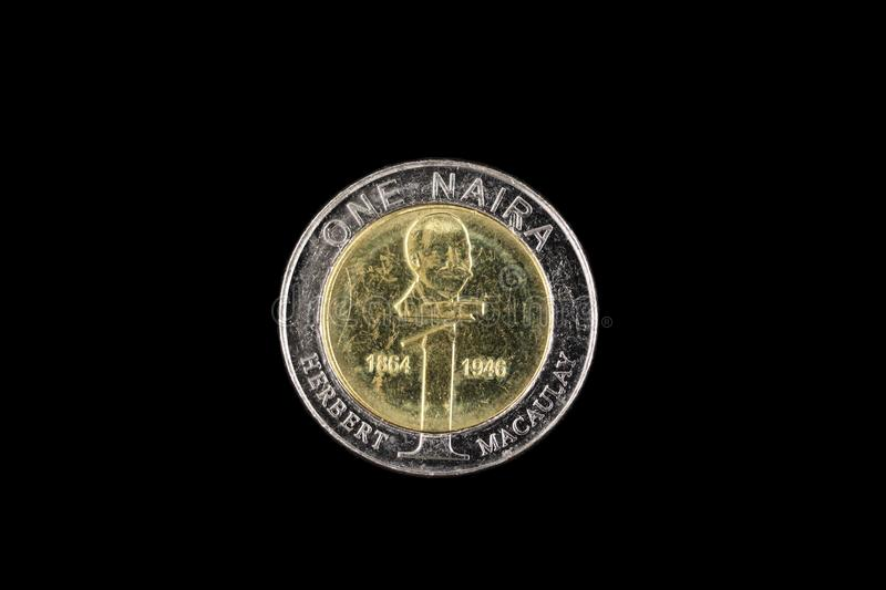 Nigerian One Naira Coin Isolated On A Black Background royalty free stock photos