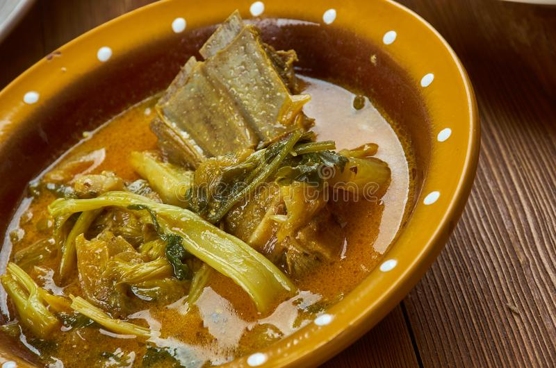 Nigerian Ora Soup. Nigerian cuisine - Ora Soup, Nigerian Bitterleaf Soup Traditional assorted dishes, Top view royalty free stock photo