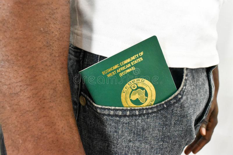 Nigerian passport in African Black man`s pocket. Nigeria west African ECOWAS Economic Community of West African States for travel and tourism royalty free stock image