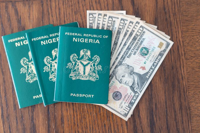 Nigerian Passport with United State Dollars for vacation or business trip royalty free stock photo