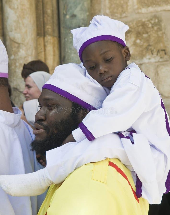 Nigerian pilgrims. JERUSALEM - APRIL 05 : Nigerian pilgrims visit the church of the Holy Sepulcher in Jerusalem Israel during Easter on April 05 2012 royalty free stock photography