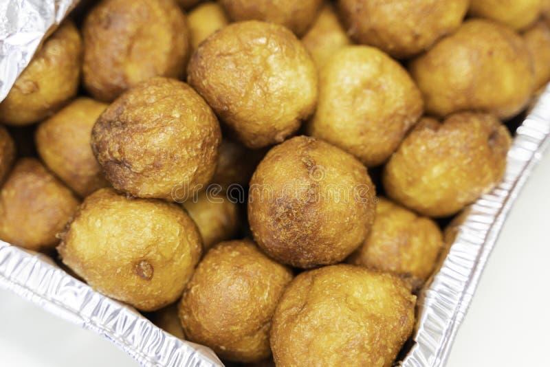 Nigerian Puff Puff on Nigerian party buffet. Nigerian Puff Puff snack on Nigerian party buffet stock photos