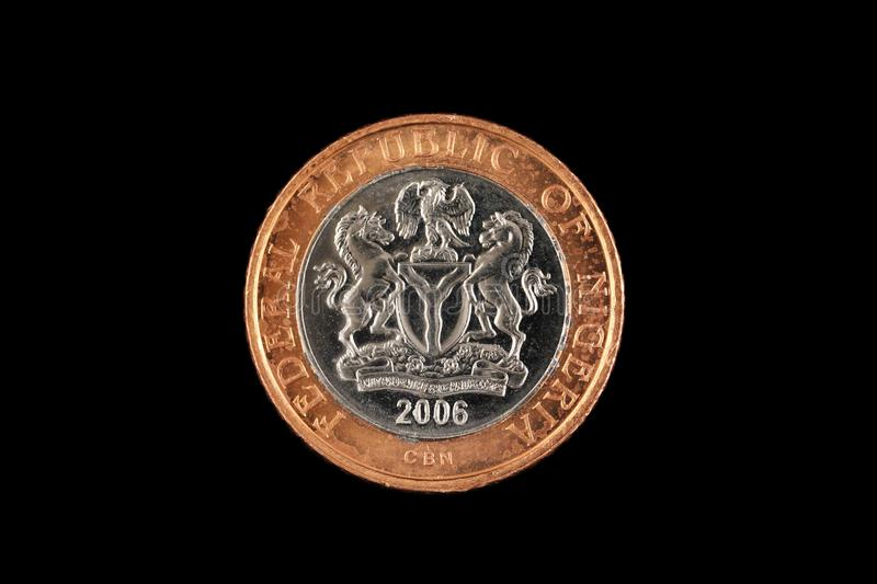 Nigerian Two Naira Coin Isolated On A Black Background royalty free stock photos