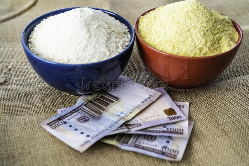 Nigerian yellow and white Garri in Bowls at marketplace. Ready to sell royalty free stock photography
