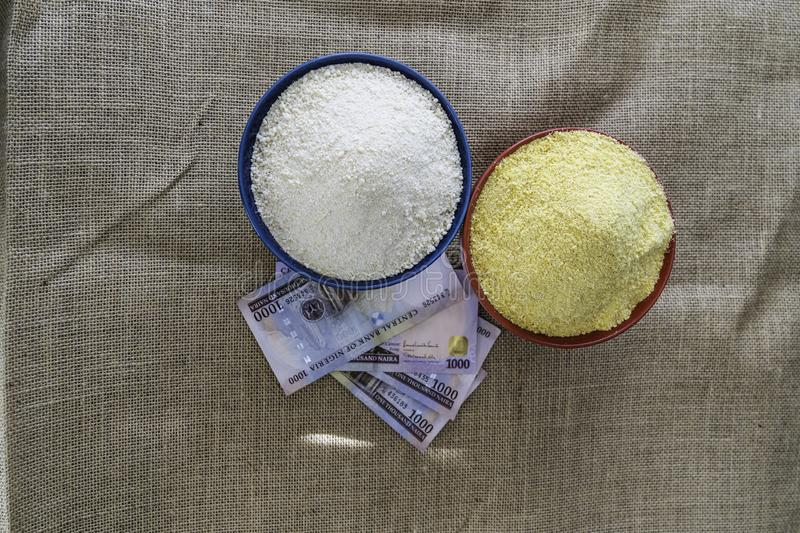 Nigerian yellow and white Garri in Bowls at marketplace. Ready to sell stock photography