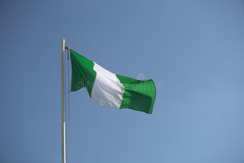 Nigeryjska flaga w wiatrze fotografia stock