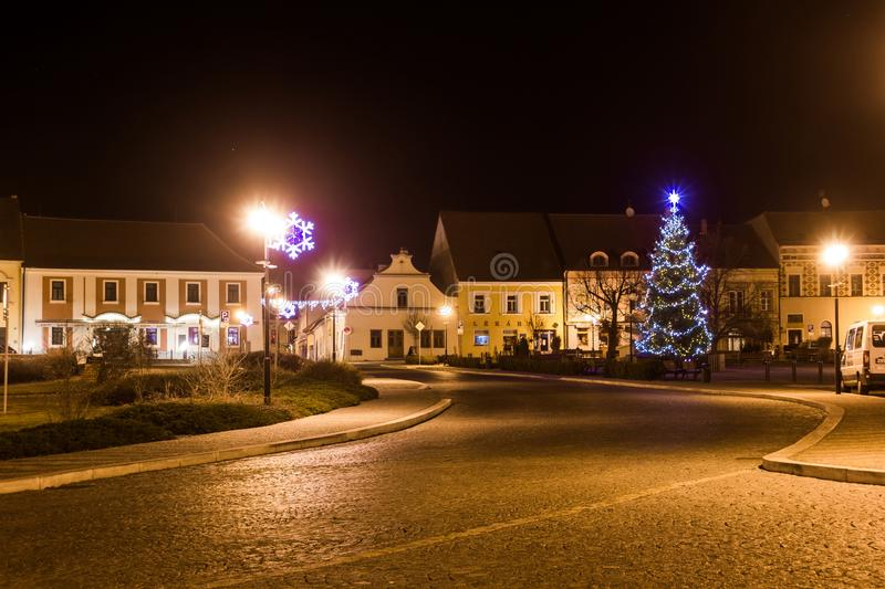 Night above historic center of Bechyne with christmas tree. stock photo