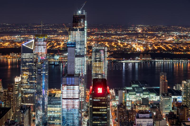 Night aerial view of Hudson Yards skyscrapers under contruction with the Hudson River. Chelsea, Manhattan, New York City, USA stock photography