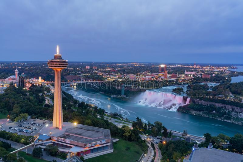 Night aerial view of the Skylon Tower and the beautiful Niagara Falls royalty free stock photography