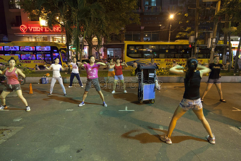 Night aerobic workout. Workout at public places in the evenings among ladies is very popular in city parks in Ho Chi Minh city. Reason is that during the night royalty free stock photography
