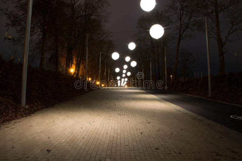 Night alley with bubble lights stock image