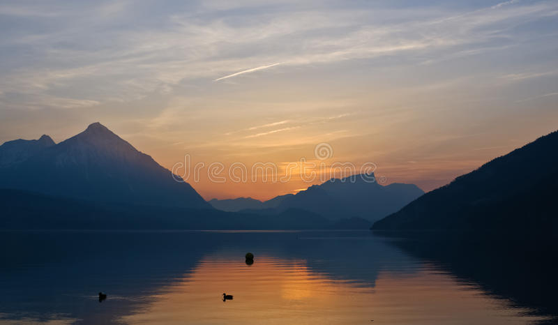 Night alps silhouette. Walking around the lake its possible to watch the sunset and mountain silhouettes royalty free stock photos