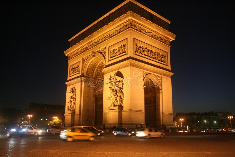 Night, angle view of Arc de Triomphe, Paris, december lights royalty free stock photography