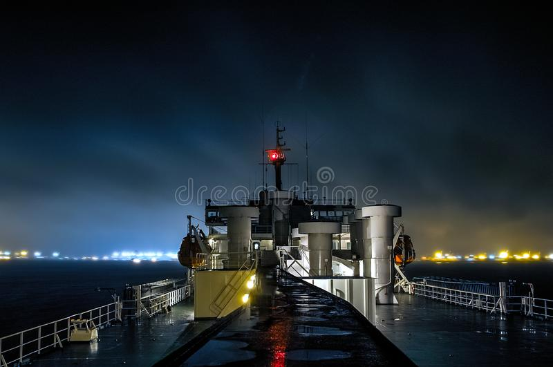 Night arrival at the port. Ship entering the port of Ust-Luga stock images