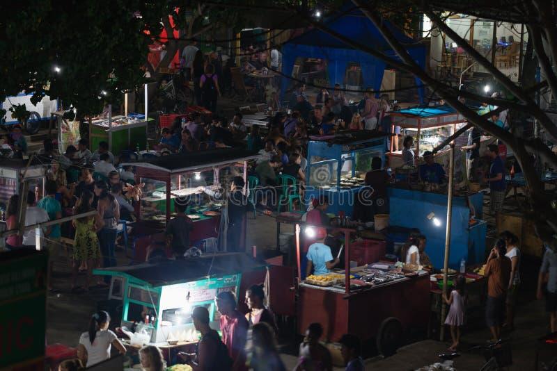 Night asian food market, Gili island, Indonesia. GILI, INDONESIA - SEP 15: People sell and do their shopping at night food market at Gili Trawangan island stock photo