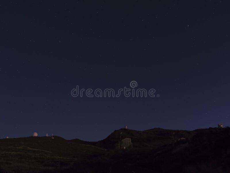 Night astrophotography, sky with stars at Roque de los Muchachos with telescopes of astronomical observatory, la Palma. Canary islands, Spain royalty free stock photography