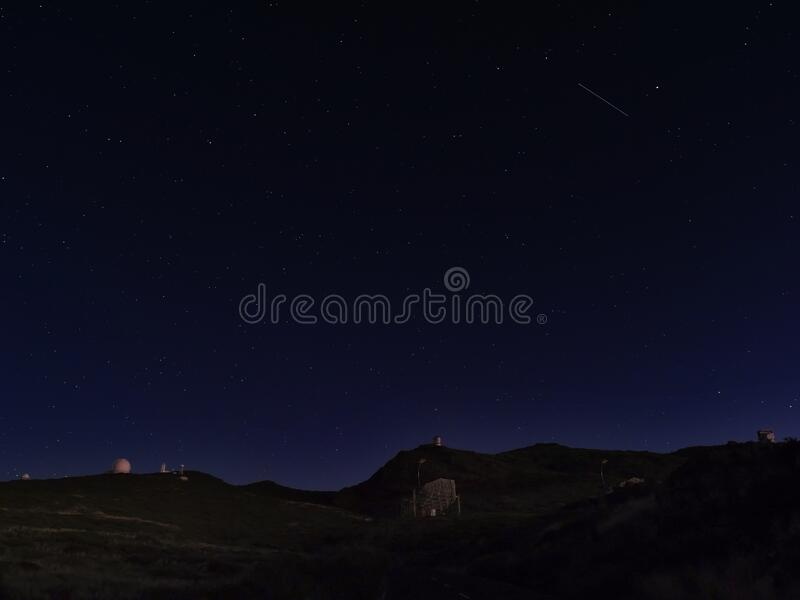 Night astrophotography, sky with stars at Roque de los Muchachos with telescopes of astronomical observatory, la Palma. Canary islands, Spain stock photography