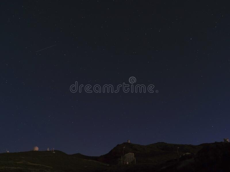 Night astrophotography, sky with stars at Roque de los Muchachos with telescopes of astronomical observatory, la Palma. Canary islands, Spain royalty free stock photo