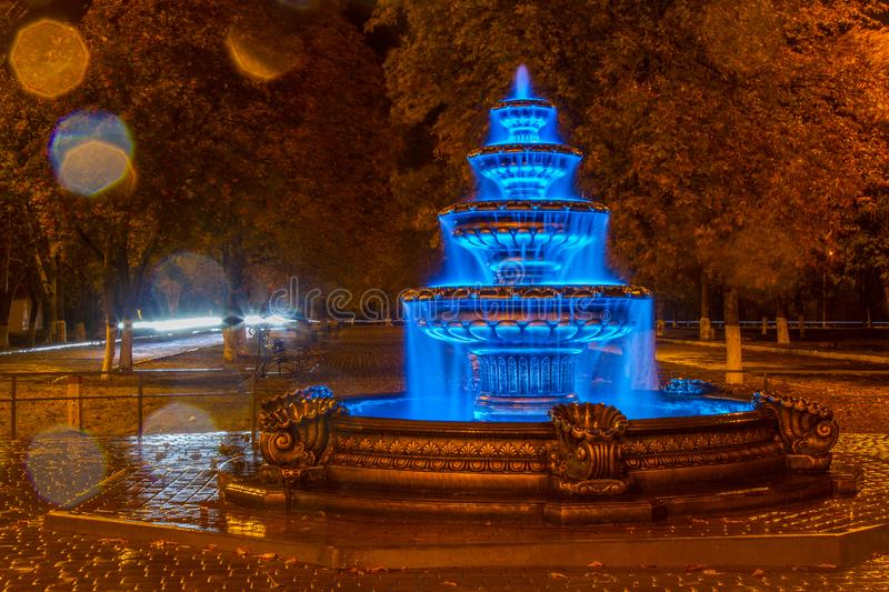Night autumn fountain. In the park of the city. Zaporozhye region. October 2017 royalty free stock photo