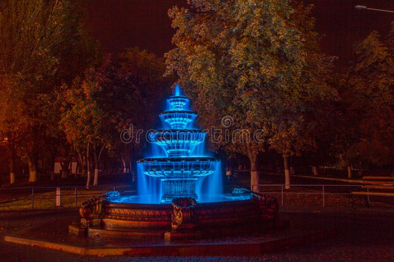 Night autumn fountain. In the park of the city. Zaporozhye region. October 2017 stock photography