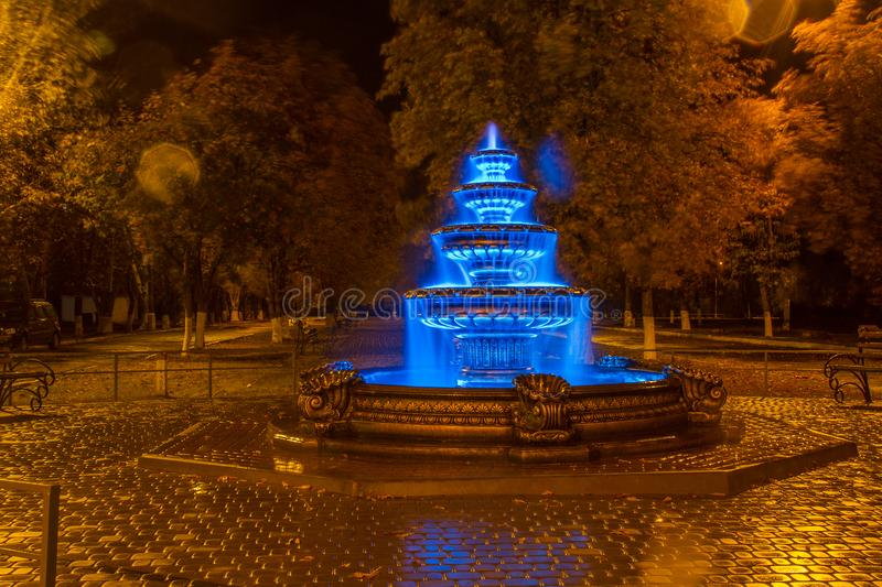 Night autumn fountain. In the park of the city. Zaporozhye region. October 2017 stock image