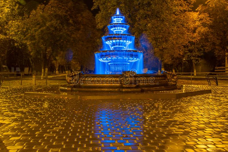 Night autumn fountain. In the park of the city. Zaporozhye region. October 2017 royalty free stock images