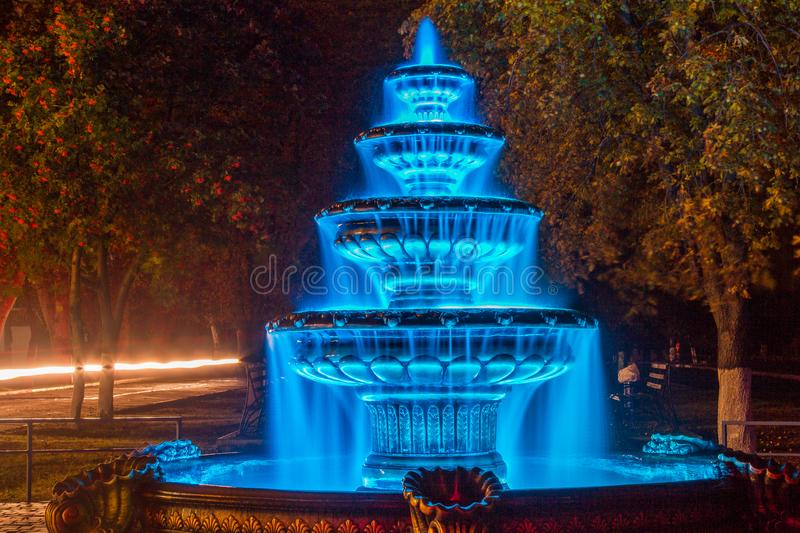Night autumn fountain. In the park of the city. Zaporozhye region. October 2017 royalty free stock image