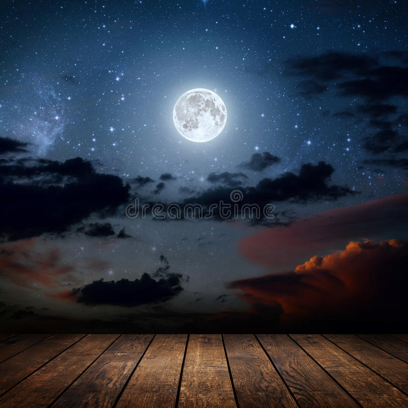 Night. Backgrounds night sky with stars, moon and clouds. wood floor. Elements of this image furnished by NASA stock photo