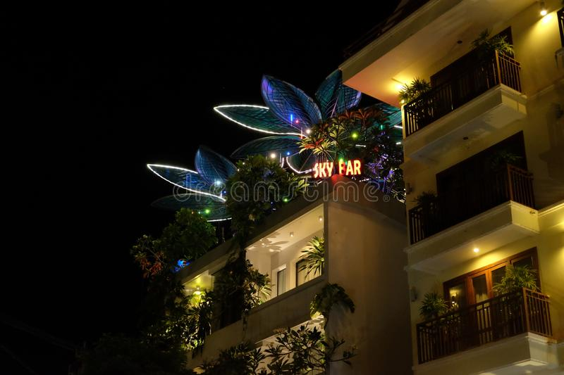 Cambodia, Siem Reap 12/08/2018 night bar on the roof of the house, neon lights. Night bar on the roof of the house, neon lights royalty free stock image