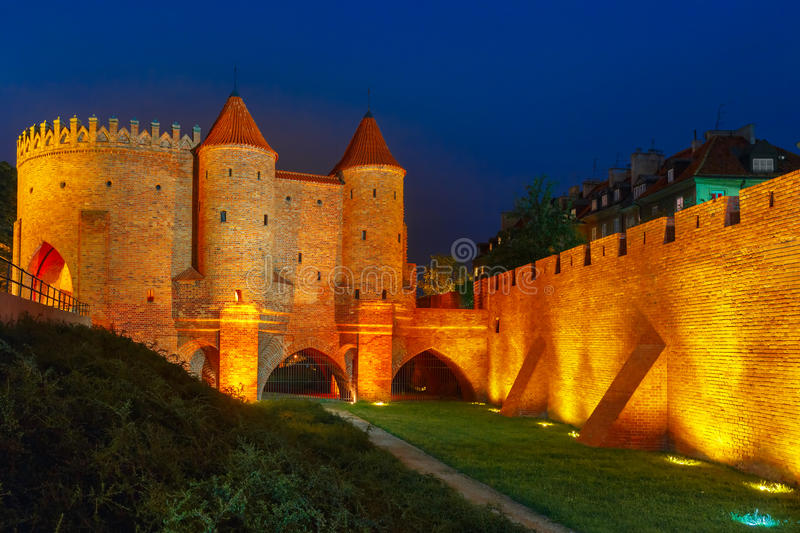 Night Barbican in the Old Town of Warsaw, Poland royalty free stock photos