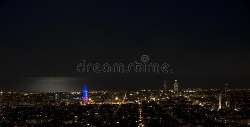 Night in Barcelona. Photo taken from a high point of Barcelona. On the left you can see the Torre Agbar, on the right we find the Sagrada Familia and the twin stock photography