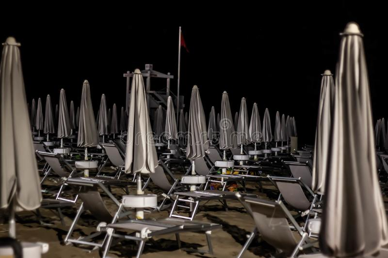 Night beach details, jesolo. to avoid acts of violence or vandalism, some seaside towns have equipped their beaches as well as sec. Urity agents, including royalty free stock photography