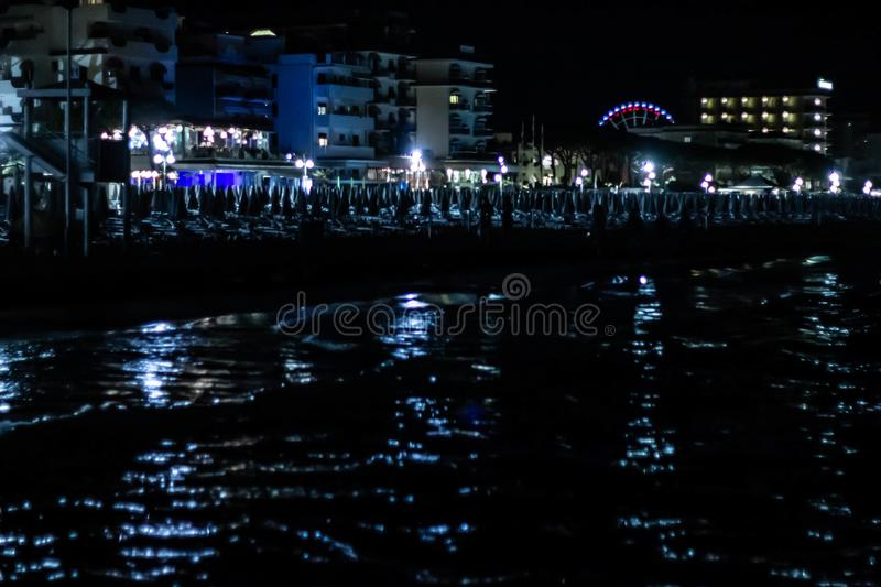 Night beach details, jesolo. to avoid acts of violence or vandalism, some seaside towns have equipped their beaches as well as sec stock photos