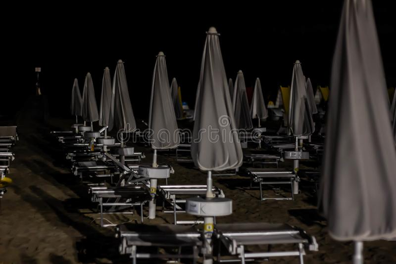 Night beach details, jesolo. to avoid acts of violence or vandalism, some seaside towns have equipped their beaches as well as sec. Urity agents, including royalty free stock photo