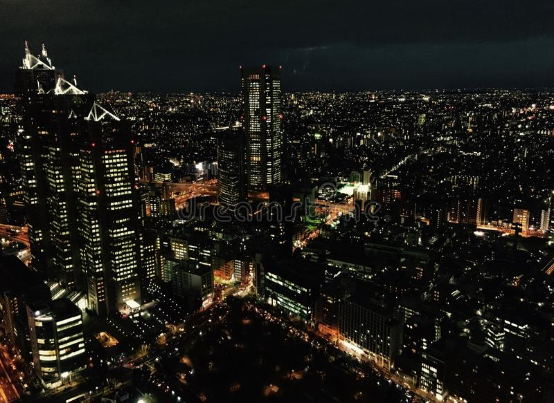Night blanket over the shimmering lights of Tokyo royalty free stock photography