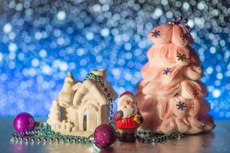Night bokeh santa claus toy and blurred lights foreground. Big New Year s concept. Market banner, poster. stock photo