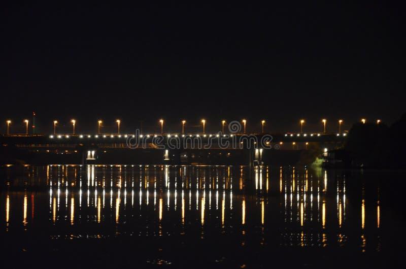 Night Bridge, Dnepr river. Bridge city lights royalty free stock image