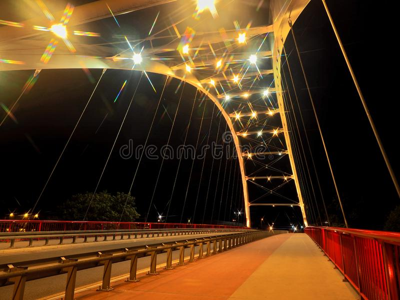 Night bridge and lights. Effectively illuminated with lights, a road bridge over the Parseta cave in Kolobrzeg stock images