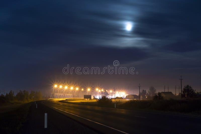 Night bridge road. Illuminated night bridge and road stock images