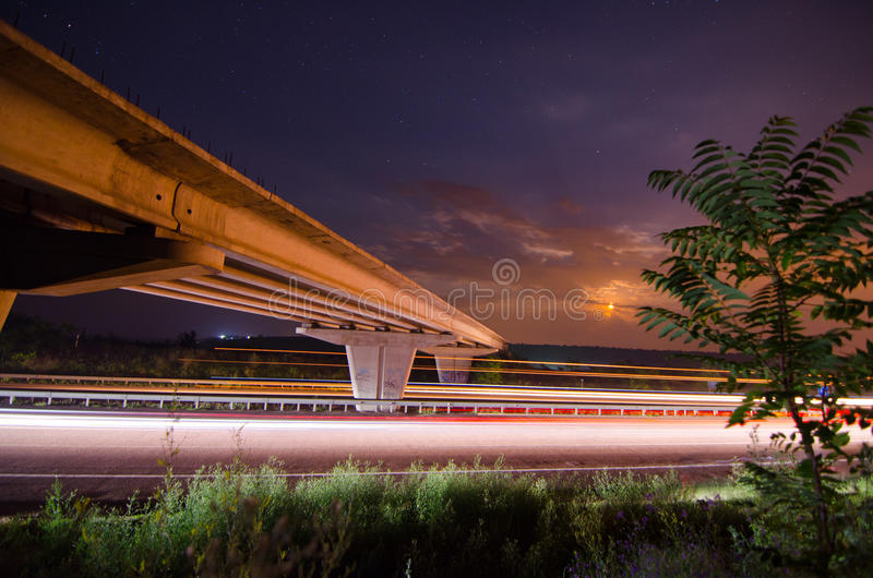 Download Night bridge to highway stock image. Image of lane, business - 33186755