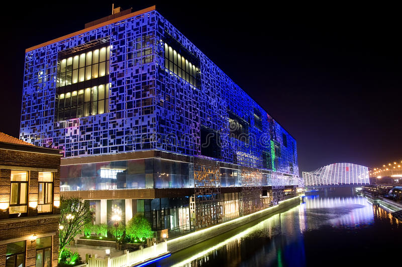 Night building near river. With colorful lights stock photo
