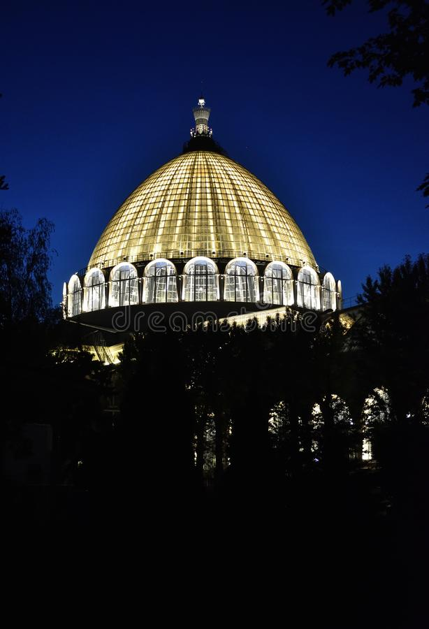 Night building In the Park exhibition of achievements of national economy. Lighted building dome stock images