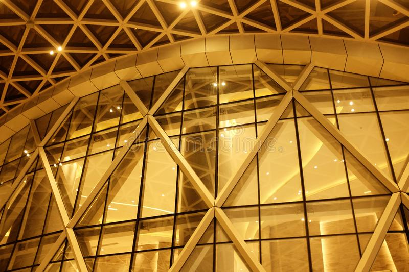 Night Building structures aluminum triangle geometry on facade of modern urban architecture..blur futuristic structures stock photo