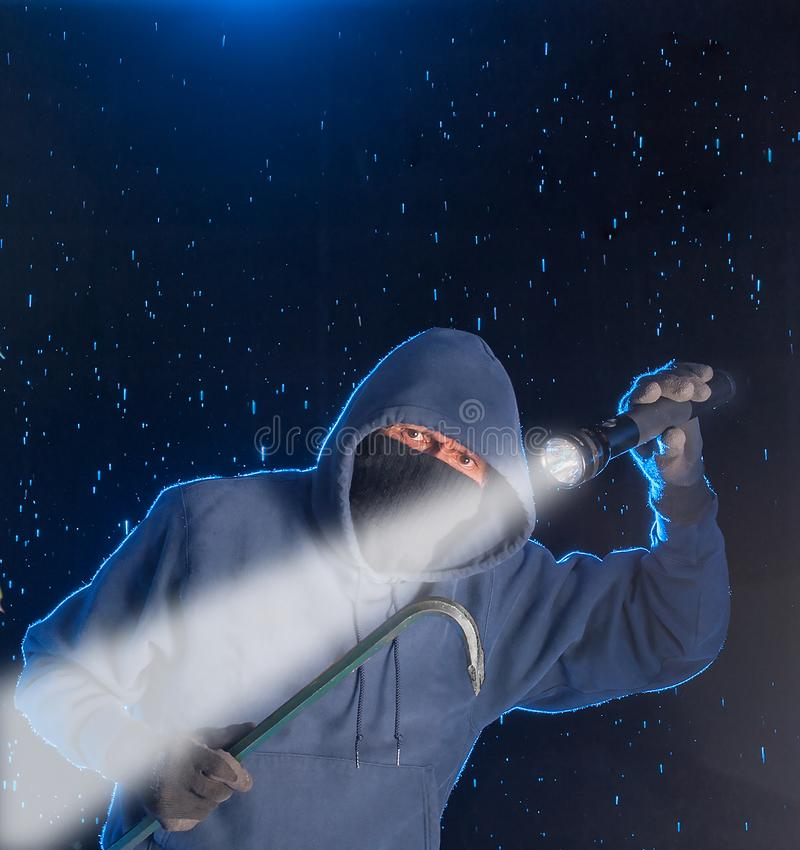 Night burglar about to break into a home royalty free stock photography